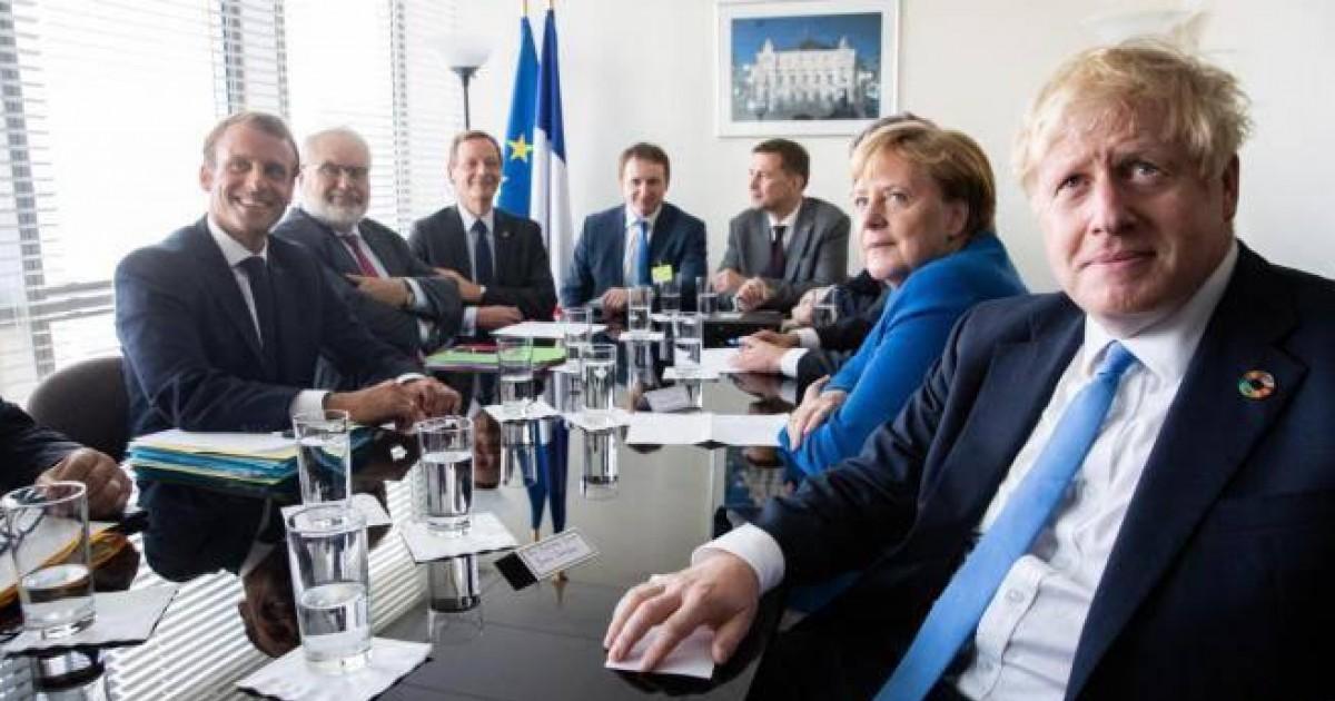 Boris Jonson, Angela Merkel y Emmanuel Macron